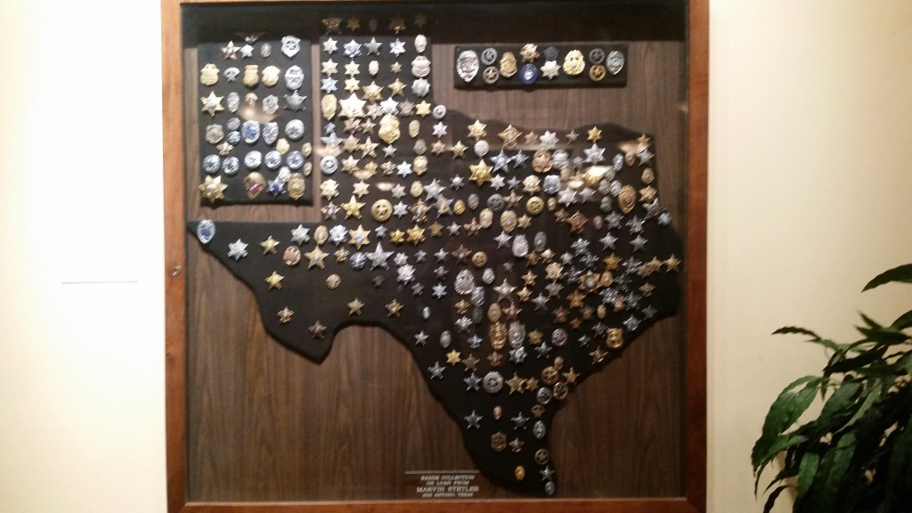 Badges from across Texas.